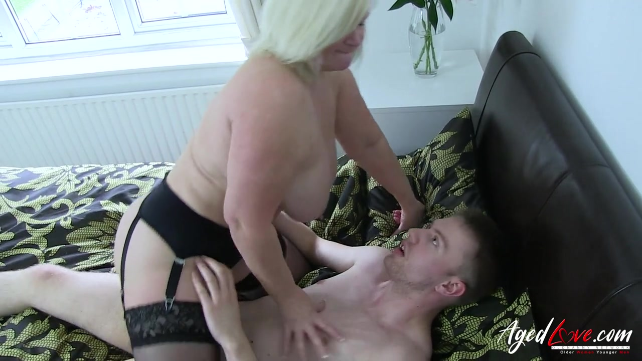 Lusty mature BBW climbs on his dick and rides