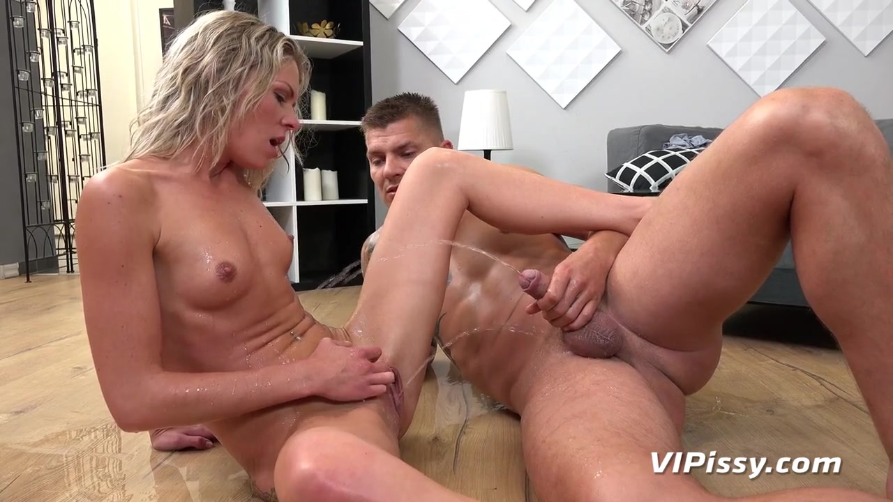 Chick pees on his cock before blowing him