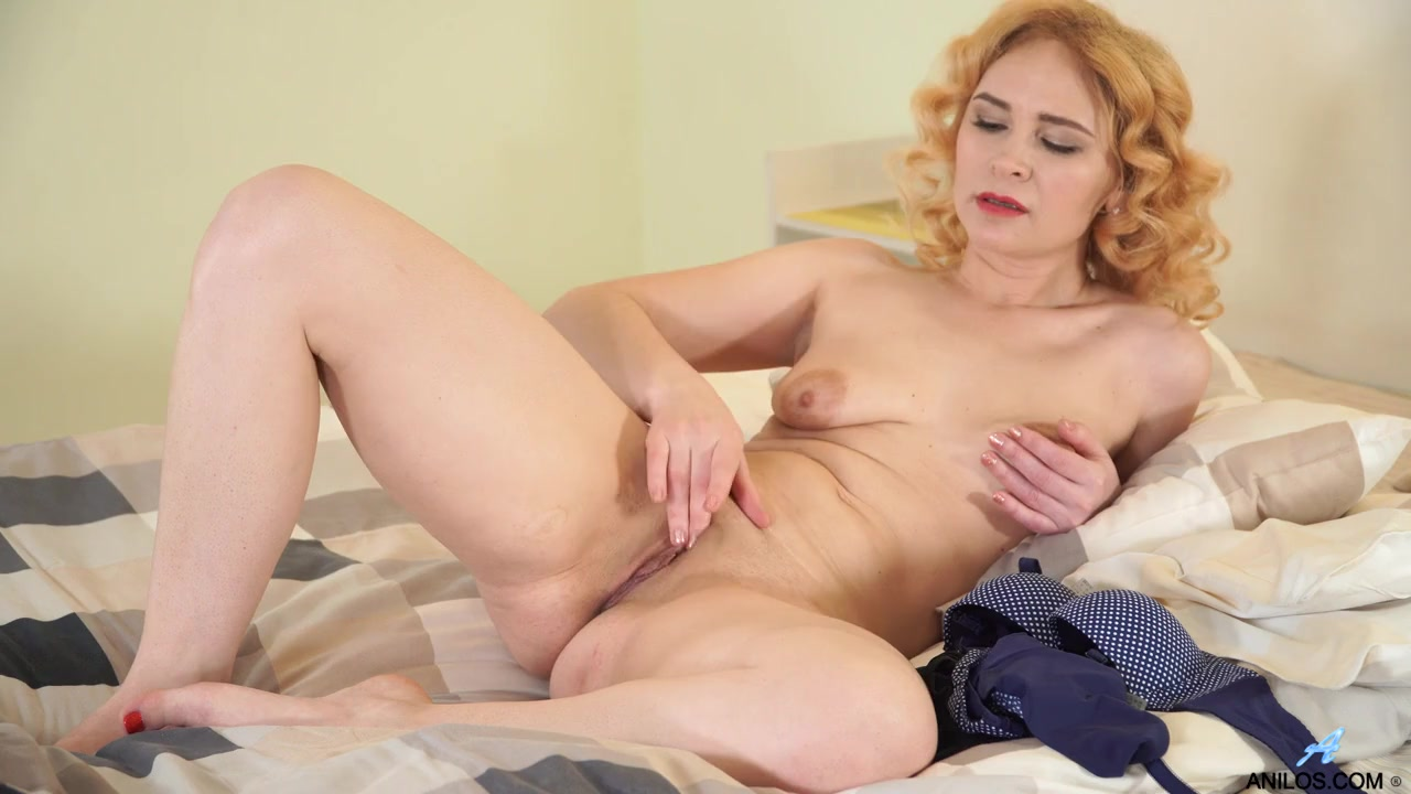 Dildo sucking mommy slides it into her slick cunt