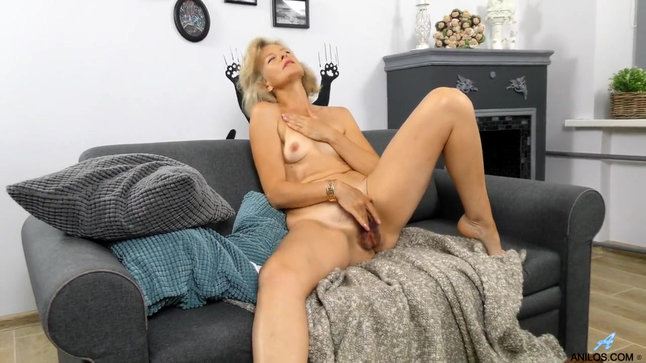 Tan stockings on a masturbating mature beauty