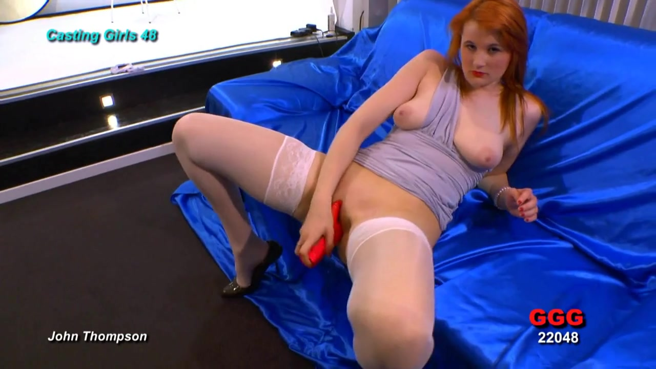 Slutty redhead stuffs a toy into her pink pussy